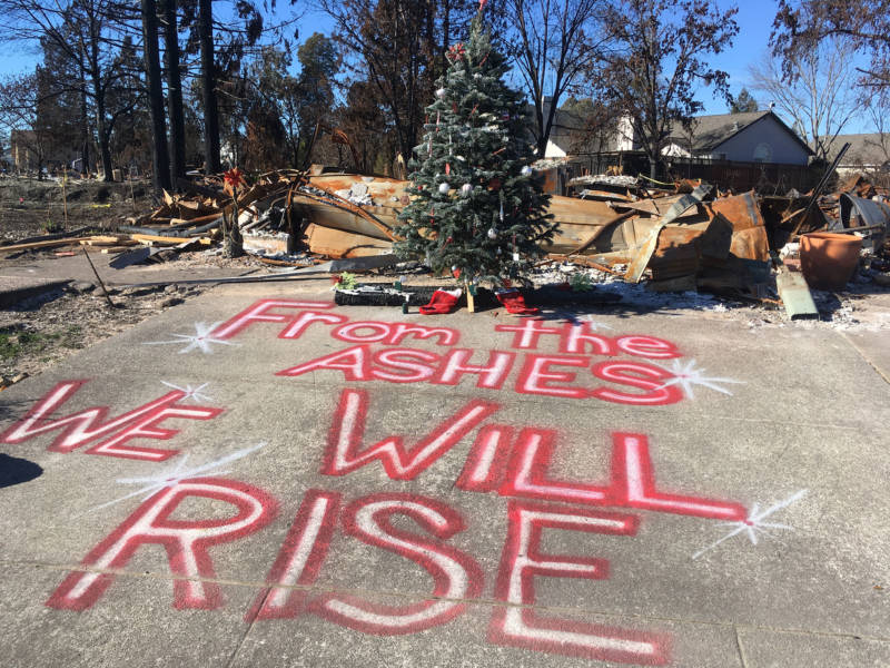 A Christmas tree stands in front of a home destroyed by October's fires in Santa Rosa.