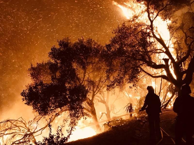 Firefighters battle flames from the Thomas Fire as they advance on homes atop Shepherd Mesa Road in Carpinteria at 6 a.m. on Sunday, Dec. 10, 2017.
