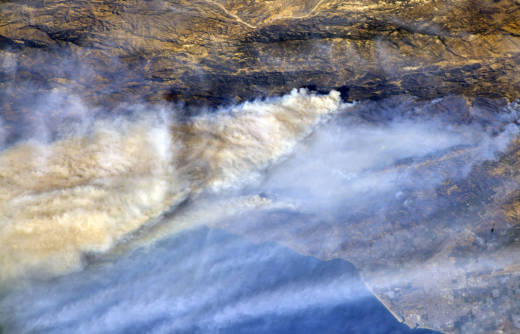 Plumes of smoke from various Southern California fires -- the largest from the massive Thomas Fire -- blow out to sea in an photo taken from the International Space Station on Dec. 8, 2017.