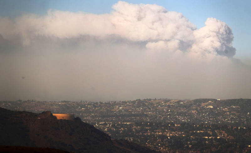 Smoke rises from the Thomas Fire on Dec. 5, 2017 in Ventura