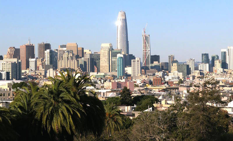 A view from Dolores Park of the San Francisco skyline with the Salesforce Tower in the center.