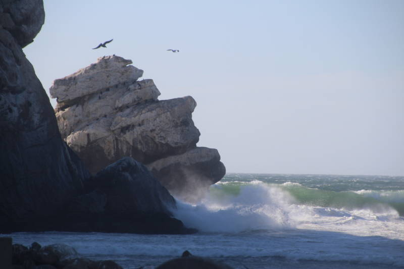 The Pacific Ocean crashes against Morro Rock, a sacred place to Salinan Indians.