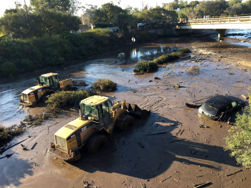 Bulldozers plow through mud and muck on the 101 Freeway on Thursday, Jan. 11, 2018, following the devastating mudslides that killed at least 17 people and destroyed dozens of homes in Santa Barbara County.