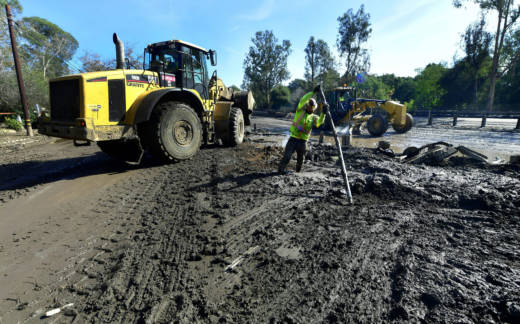 Cleanup operations continue along a section of the 101 freeway closed due to mudslides in Montecito on January 12, 2018.
