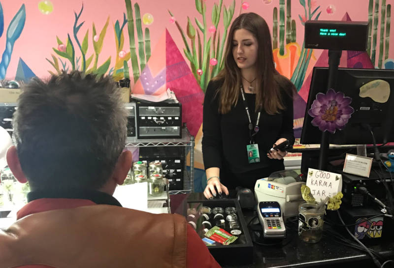 An employee helps a customer at Buddy's Cannabis in San Jose.