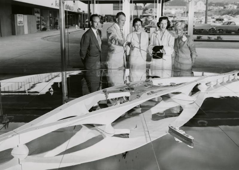Model of the Butterfly Bridge at Stonestown Shopping Center, San Francisco, 1953. L to R: Aaron Green, Arthur Haggard, Mrs. Donald Magnin, Mary Lee Futernick, and Carol Weingarten.