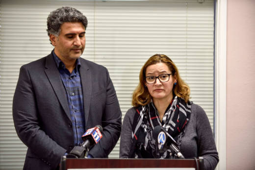 Azfar Quddus and Carolyn Rodriguez-Quddus make a statement to the media during a press conference in Anaheim on Jan. 11, 2018.