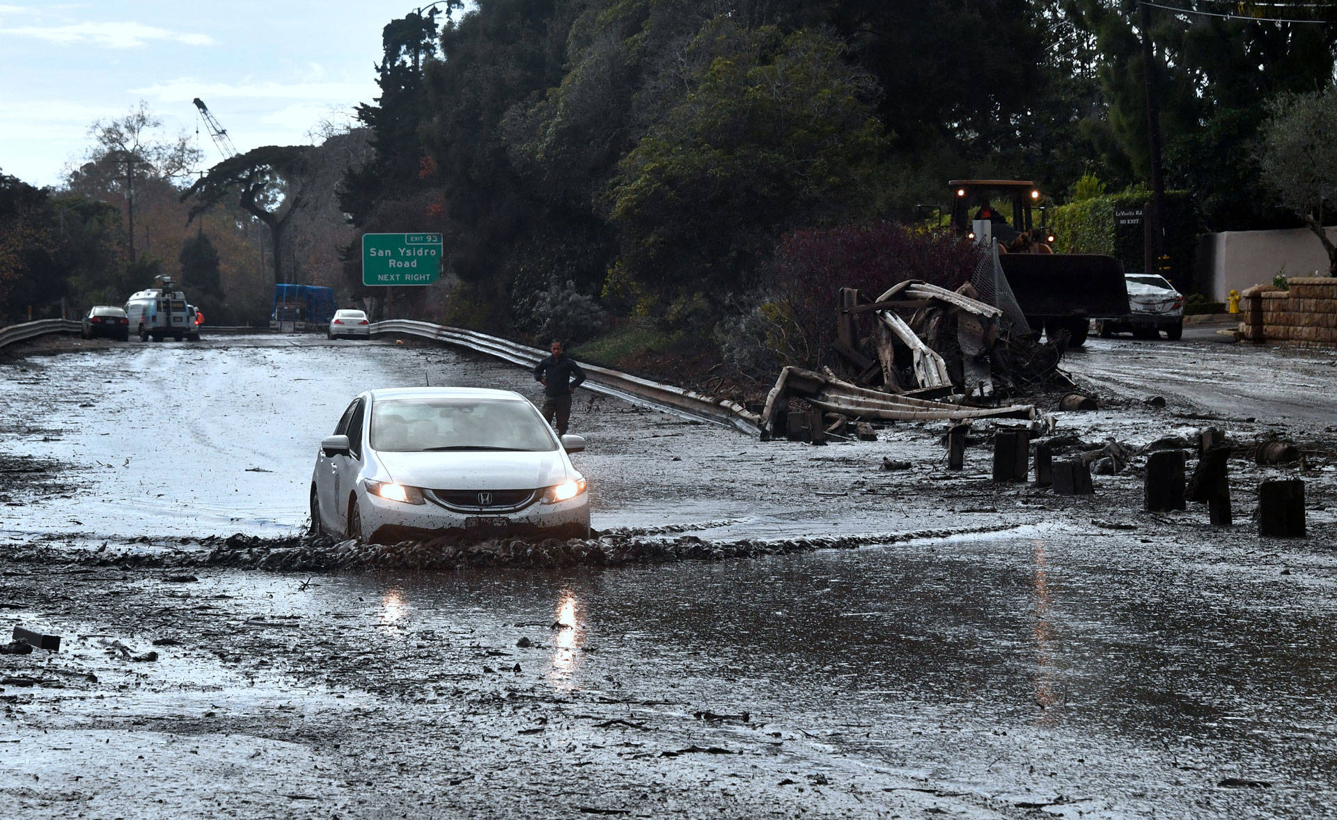 A vehicle drives across the flooded US 101 freeway in Montecito on January 9, 2018. FREDERIC J. BROWN/AFP/Getty Images