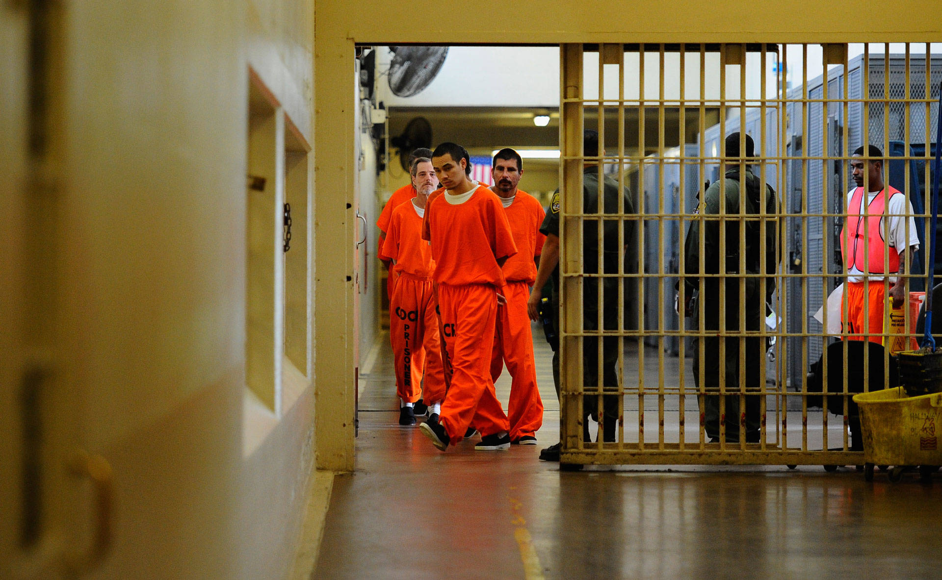 Inmates at Chino State Prison walk the hallway in 2010. Kevork Djansezian/Getty Images
