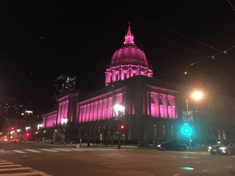 San Francisco City Hall is lit up pink at night on Saturday, Jan. 20, 2018. Earlier in the day, tens of thousands of women gathered in front of City Hall and marched down Market Street as part of the 2018 Women's March.