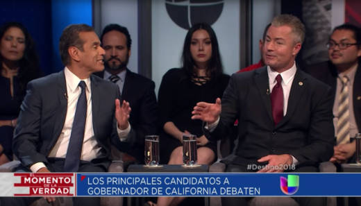 Former Los Angeles Mayor Antonio Villaraigosa (L) and Republican State Assemblyman Travis Allen engage in a heated exchange over immigration during Thursday's gubernatorial election forum.