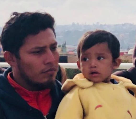 Jose Demar Fuentes carries his son Mateo near the San Ysidro Port of Entry, Nov. 12, 2017. A spokeswoman for ICE said the agency separated the pair because Fuentes could not provide documentary proof that he was the father of the child.