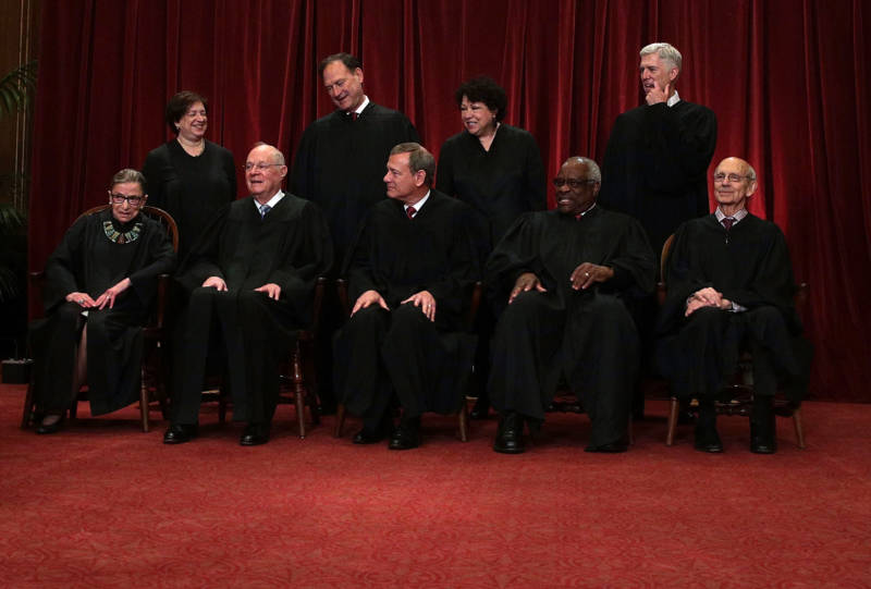 Justice Ruth Bader Ginsburg in the front row of the U.S. Supreme Court group portrait shortly after Justice Gorsuch had joined in 2017.