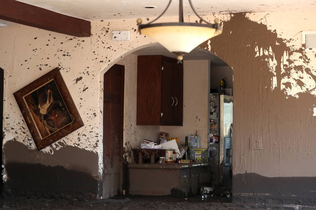 Mud fills a home that was destroyed by a mudslide on January 12, 2018 in Montecito, California. Mudslides killed at least 21, injured dozens and damaged or destroyed hundreds of homes.