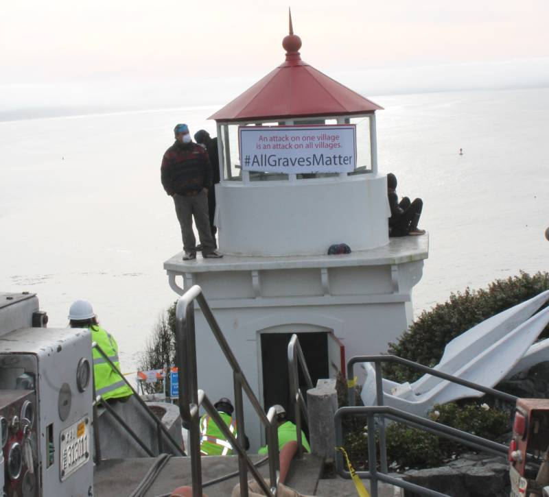 Protesters, including Lucas Garcia, a descendant of the Tsurai Ancestral Village and member of the Yurok Tribe, climbed to the top of the Trinidad Memorial Lighthouse on December 28, 2017 to stop its relocation. They say it puts the village in jeopardy. Meanwhile construction continued to take place at the base of the structure.