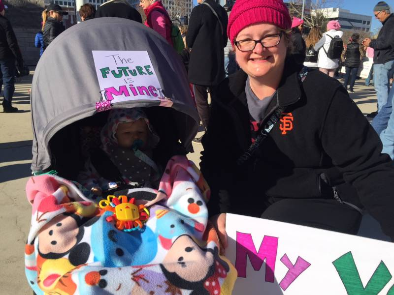 Karen Corpron, from Gilroy, and her baby at the San Jose Women's March. Karen's baby was born this time last year.