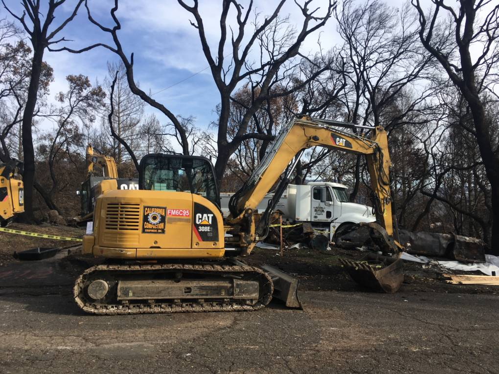 Army Corps' contractors clear a homesite near Mark West Springs Road in Santa Rosa.
