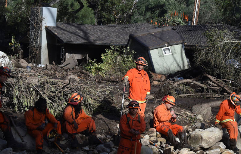 A Cal Fire inmate crew rests while looking for victims of a massive mudflow in Montecito on January 10, 2018.