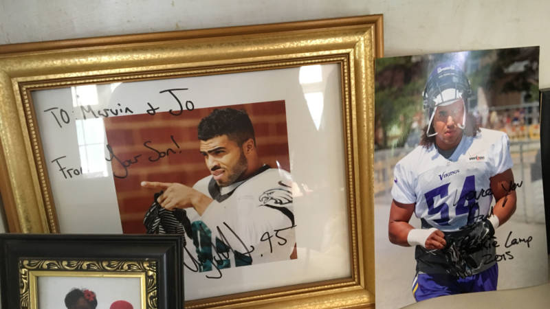 Marvin Kendricks cherishes signed photos of his sons, Mychal and Eric, both NFL players.