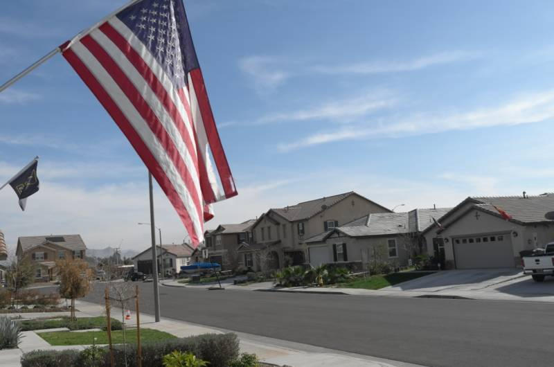 A flag flies in the neighborhood of Monument Park in Perris, Calif.