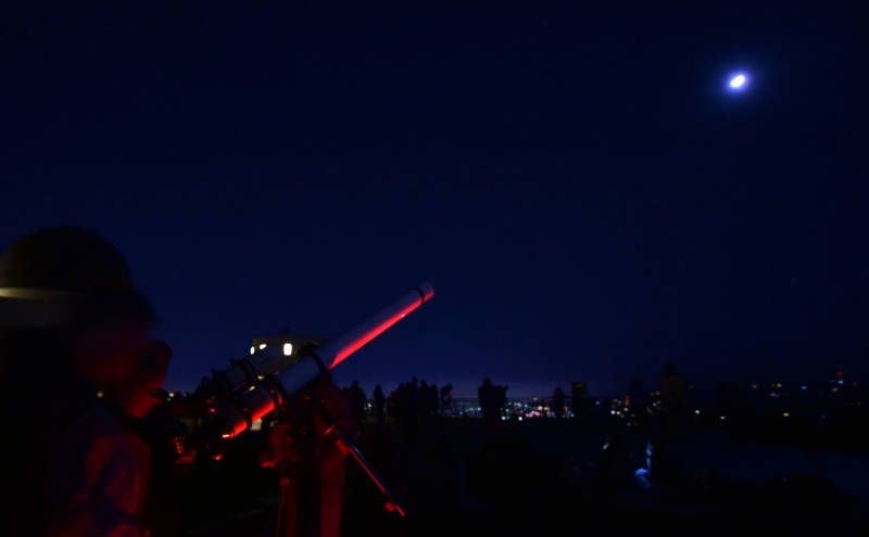 Moongazers attend a lunar eclipse celebration at Griffith Observatory in Los Angeles early on Jan. 31, 2018.