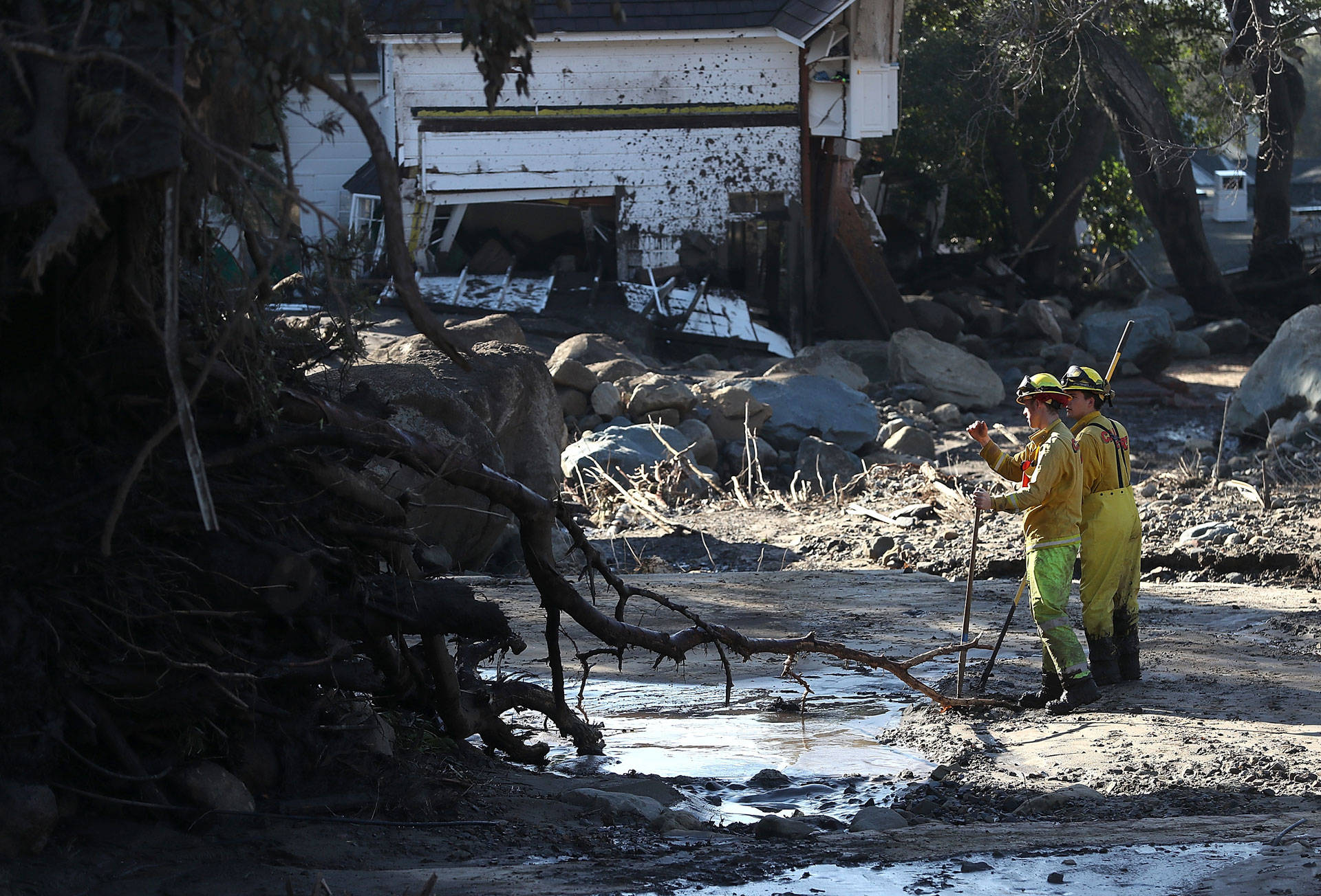 Cal Fire firefighters search a neighborhood on Jan. 12, 2018, in Montecito that was destroyed by a mudslide. Justin Sullivan/Getty Images