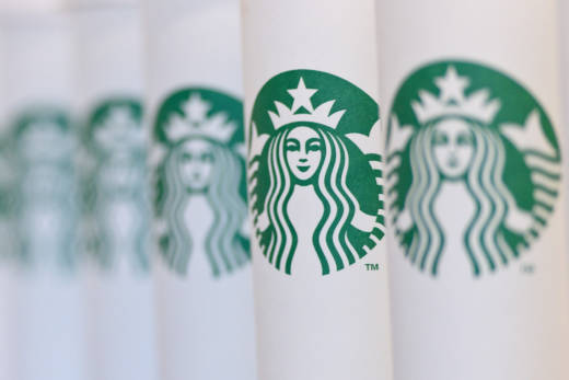 A row of Starbucks cups.