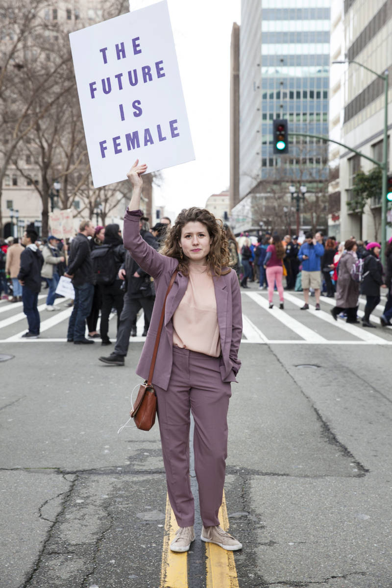"Elizabeth Herman, of Oakland, Ca., carried a sign reading The ""Future is Female"" during the Women's March in Oakland on Saturday, Jan. 21, 2017."