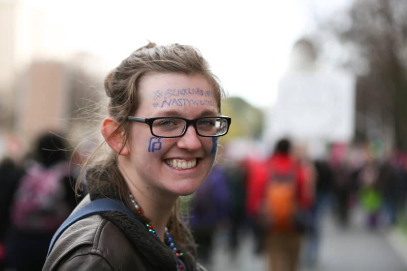 Barbara Wortham of Davis marched down the Capitol Mall during the Sacramento Women's March on Saturday, Jan. 21, 2017. She painted her face with the logo for Planned Parenthood and the hashtags #blacklivesmatter and #nastywomen.