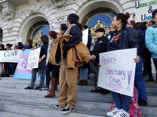 San Francisco groups rallied outside City Hall on Jan. 25, 2017, in protest of President Donald Trump's executive orders regarding immigration enforcement.