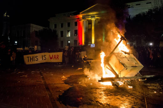 A lighting structure outside of Sproul Hall is knocked over and lit on fire during an Anti-Milo Yiannopoulos protest on February 1, 2017.