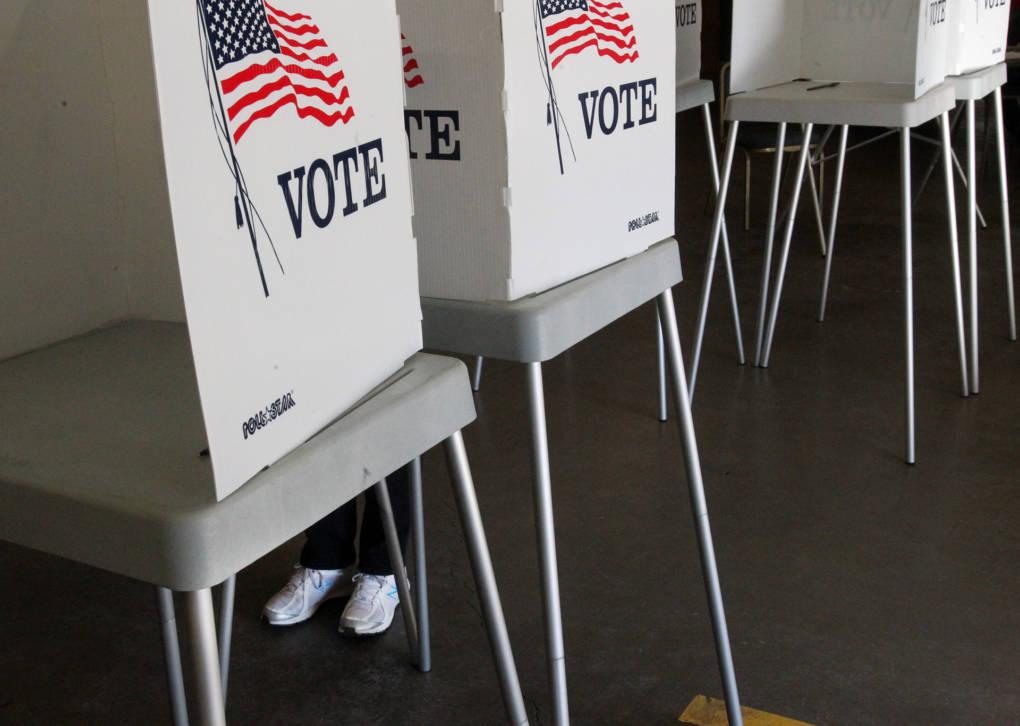 A voter casts their ballot.