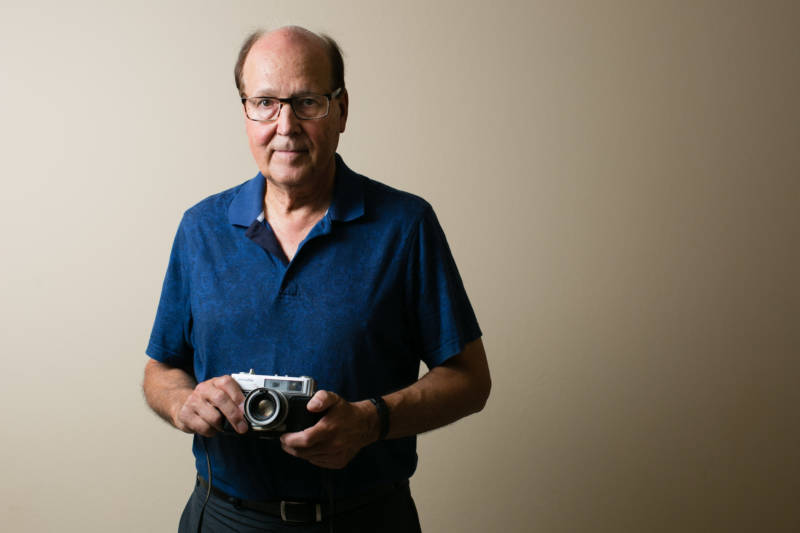Steven Burchik served in the U.S. Army during the Vietnam War. While he was deployed, he bought a camera and took photos of his fellow soldiers, Vietnamese villagers and the countryside – photos he didn't show anyone for 40 years after he got home. He was photographed in his home on Sept. 13, 2017.