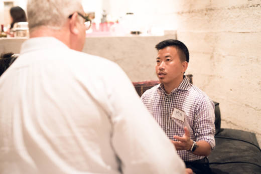 Min Matson, a transgender, liberal, Korean adoptee talks with Walt Shjeflo, a conservative who voted for President Trump, at Make America Dinner Again.
