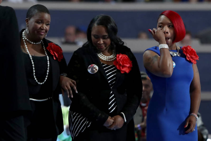 Left to right: Cleopatra Pendleton-Cowley, mother of Hadiya Pendleton; Wanda Johnson, mother of Oscar Grant; and Lezley McSpadden, mother of Mike Brown stand on stage prior to delivering remarks on the second day of the Democratic National Convention at the Wells Fargo Center, July 26, 2016, in Philadelphia. Johnson says she meets annually with other mothers who have lost loved ones to police violence.