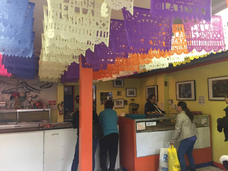 Customers purchase Three Kings Cake at La Reyna Bakery in San Francisco's Mission District on Jan. 6, 2018.