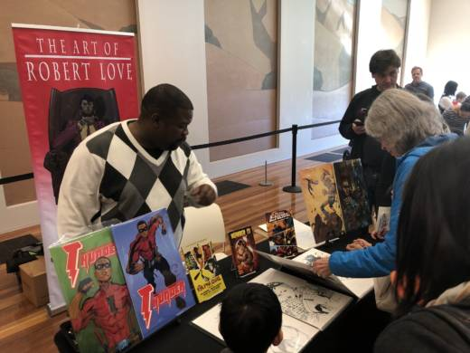 Illustrator Robert Love showcases some of his comic book art at the de Young museum as part of the Black Comix Arts Festival.