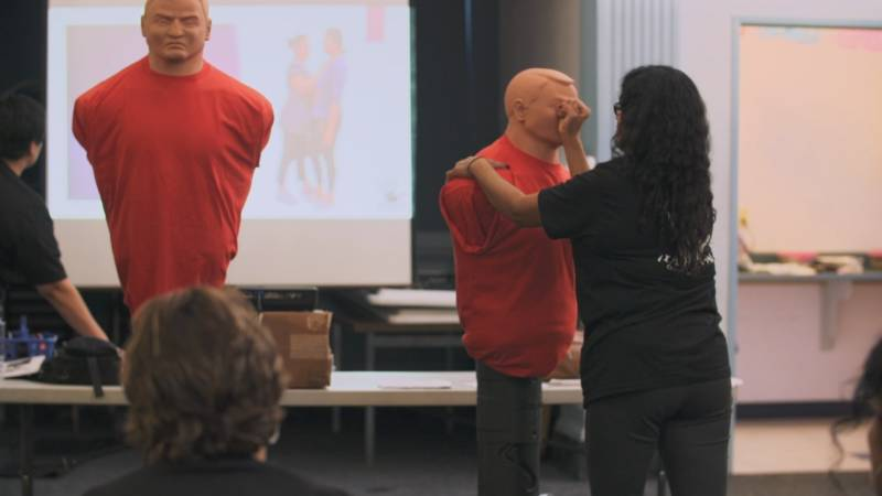 Janitors learn how to fend off attackers on the job at a self-defense class.