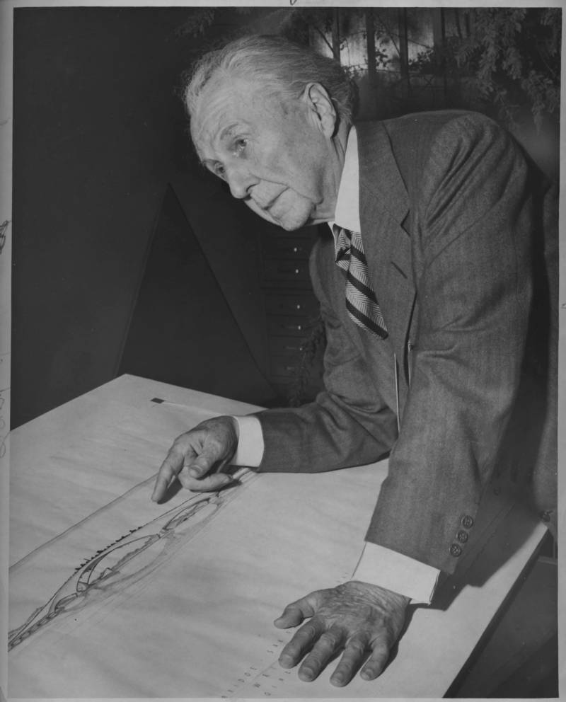 Master architect Frank Lloyd Wright in 1956, looking over his drawing of the Butterfly Bridge.