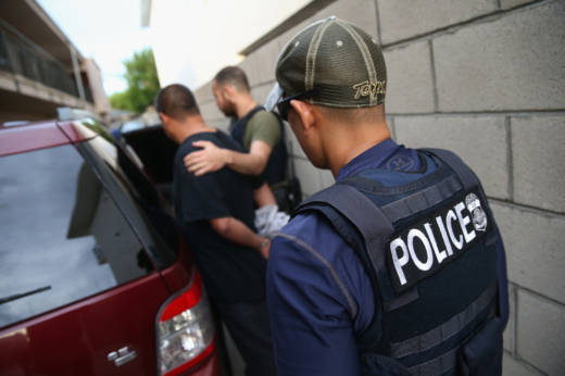 A man is detained by U.S. Immigration and Customs Enforcement (ICE), agents on October 14, 2015 in Los Angeles, California.