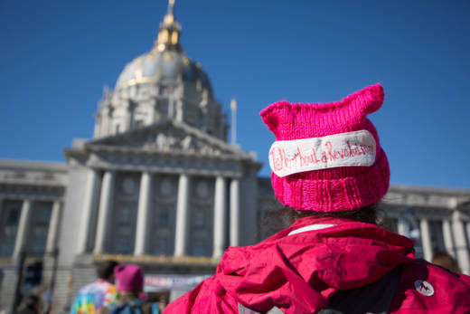 """Amanda Hammond stands in front of City Hall in San Francisco awaiting the begin of the 2018 Women's March. She hopes to continue to """"support the movement"""" after marching in Washington D.C. last January."""