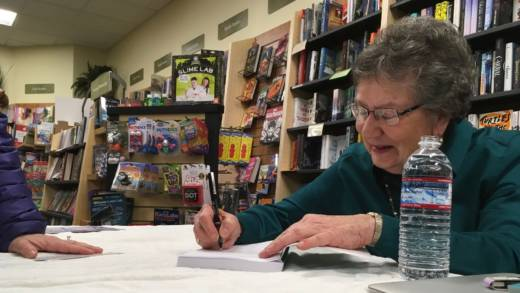 Elisabeth Seaman signs copies of her book Conflict: The Unexpected Gift at Books, Inc. in Mountain View.