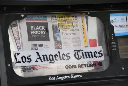 "Lewis D'Vorkin, the embattled editor in chief of ""The Los Angeles Times,"" is being replaced by veteran Chicago journalist Jim Kirk in a dramatic shakeup at the newspaper that follows weeks of tumult in the newsroom. D'Vorkin will become chief content officer for parent comapny Tronc."