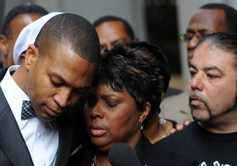 Wanda Johnson, center, is comforted by her supporters outside the Los Angeles Superior Court on July 8, 2010, after the involuntary manslaughter verdict against former BART police officer Johannes Mehserle, who was charged in the death of her son, Oscar Grant. The trial was moved to Los Angeles because of a racially charged atmosphere in Oakland, where the shooting took place.