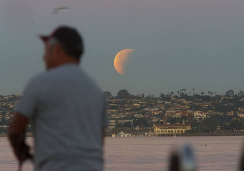 The super blue blood moon sets in San Diego on January 31, 2018.