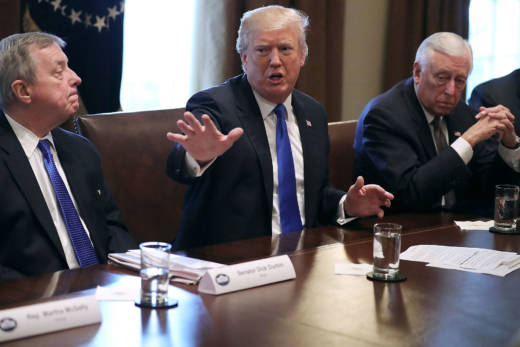 """President Trump says he is prepared to """"take the heat"""" for a compromise immigration deal."""