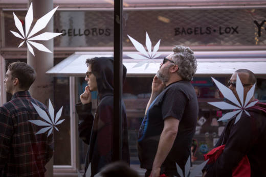 People stand in line to get into MedMen, one of the two Los Angeles area pot shops that began selling marijuana for recreational use on January 2, 2018 in West Hollywood.