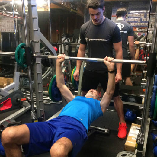 Eric Trefelner works out with his trainer Lance Becker at a gym in Montara.