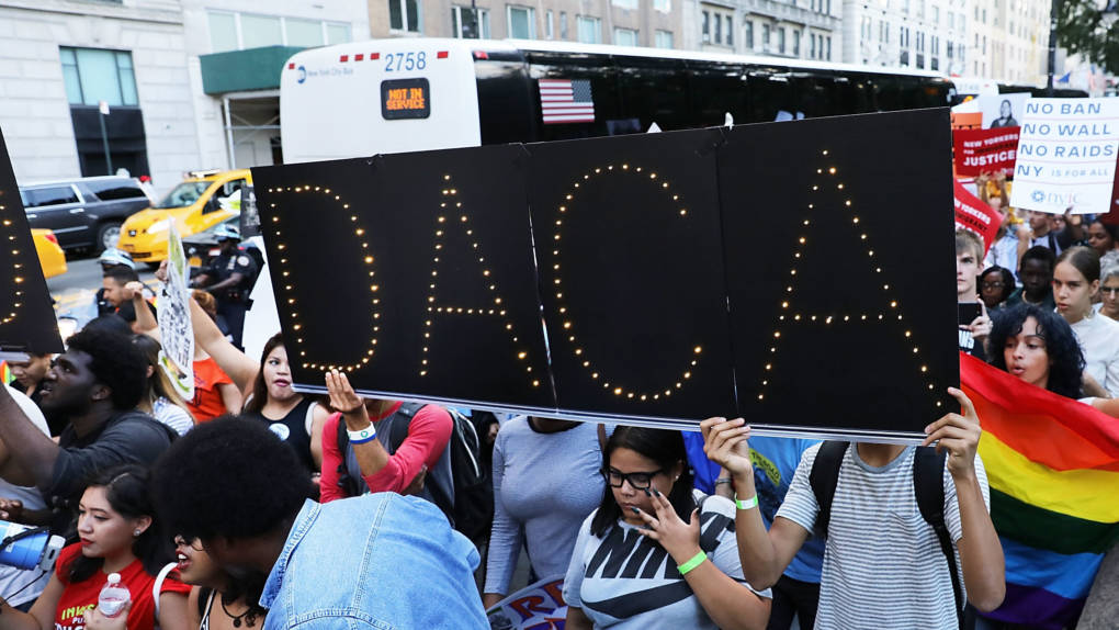 DACA advocates march near Trump Tower in August in New York City. The government says it will resume DACA renewals.