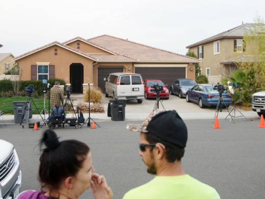 The home where a couple was arrested after police discovered that 13 people had been held captive in filthy conditions, with some shackled to beds with chains and padlocks, in Perris, Calif.